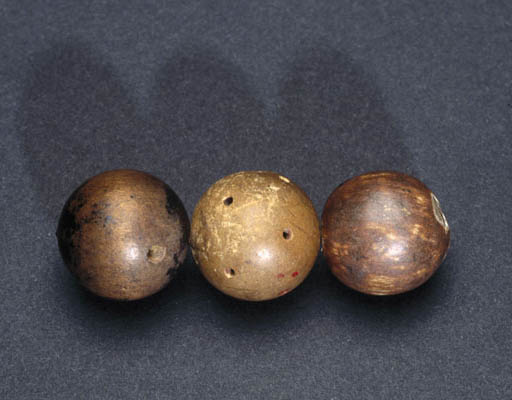 These are the actual wood spheres that Dalton used as models for atoms.